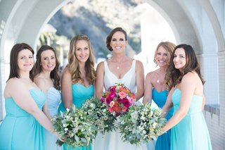 bride-and-bridesmaids-smile-blue-dresses-pink-flowers-green-bouquets