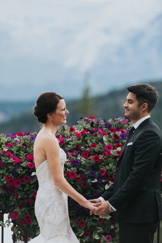 groom-in-ermenegildo-zegna-bride-in-watters-banff-national-park-gladiolus