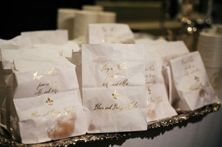 beignet-wedding-favors-white-bags-with-gold-calligraphy-beignet-wishes-from-the-new-mr-and-mrs