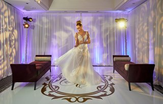 model-bride-twirling-designer-gown-pallas-couture-australian-bridal-shop-plunging-neckline-overskirt