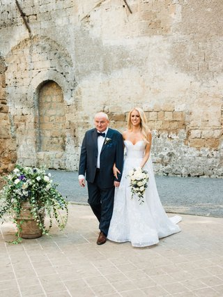 bride-in-sweetheart-neckline-strapless-wedding-dress-neutral-bouquet-with-father-of-bride-stone-wall