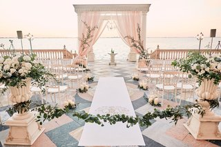 ca-dvan-wedding-ceremony-on-porch-overlooking-ocean-chiavari-chairs-in-half-circle-blush-chuppah