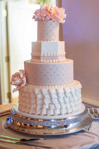 wedding-cake-with-with-white-and-pastel-pink-layers-quilted-and-pearl-dot-pattern-ruffles