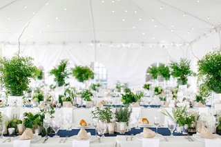tent-wedding-reception-with-nautical-theme-navy-blue-table-runner-and-greenery-centerpieces