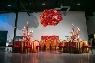fire-inspired-wedding-styled-shoot-floral-arrangements-in-orange-red-yellow-foil-installation