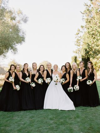 bride-in-martina-liana-ball-gown-bridesmaids-in-black-monique-lhuillier-dresses-with-v-neck