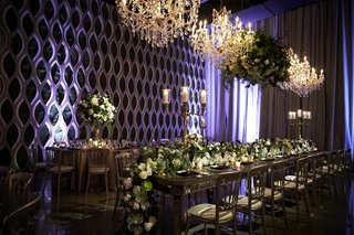 head-table-with-floral-runner-of-cream-blossoms-and-greenery-chandeliers