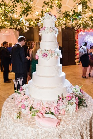 white-wedding-cake-with-seven-tiers-with-fresh-flowers