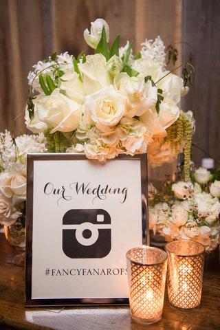 framed-sign-displaying-wedding-hashtag-for-instagram