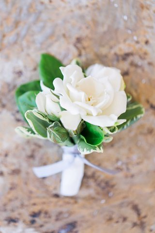 gardenia-wedding-boutonniere-with-green-leaves-and-grey-ribbon