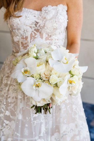 bride-in-reem-acra-wedding-dress-from-dimitras-bridal-couture-with-white-rose-orchid-bouquet