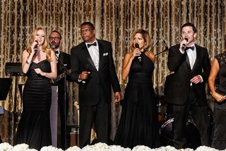 live-band-in-all-black-dresses-and-tuxedos-at-chicago-wedding-reception-on-stage