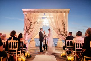 ca-dvan-outdoor-wedding-ceremony-at-night-overlooking-sarasota-bay