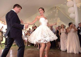 bride-twirls-in-mark-zunino-for-kleinfeld-short-wedding-dress-with-flower-embellishments-sheer-back