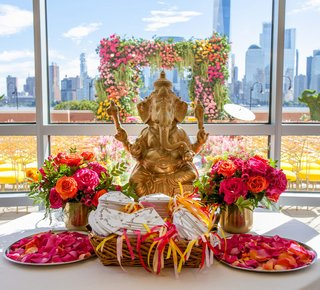 wedding-table-at-ceremony-with-programs-and-rose-petals-bright-multicultural-wedding-indian-japanese