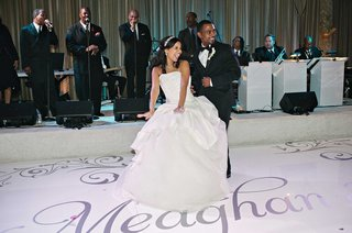 bride-in-vera-wang-wedding-dress-and-groom-dance-on-custom-dance-floor-to-sounds-of-brian-mcknight