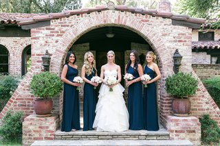 bride-in-a-strapless-hayley-paige-dress-and-bridesmaids-in-one-shoulder-monique-lhuillier-dresses