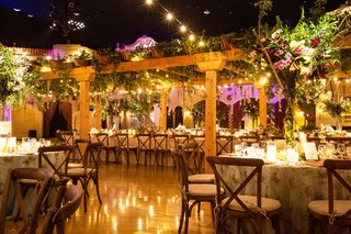 wedding-reception-with-wood-pergola-long-table-vineyard-chairs-flower-print-table-linens-centerpiece