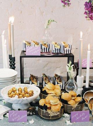 wedding-event-food-display-calzone-on-mini-armchair-chicken-sandwiches-black-white-stripes