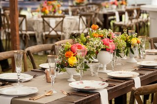 white-vases-on-rustic-wedding-wood-table-with-pink-peony-orange-yellow-flowers-greenery-rose-gold