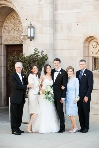 bride-and-groom-with-parents-respectively-at-st-monica-church-in-santa-monica