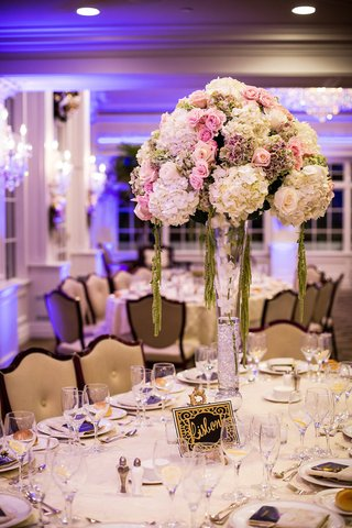 wedding-reception-centerpiece-of-white-green-purple-hydrangeas-pink-white-roses-in-trumpet-vase