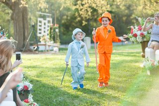 ring-bearers-dressed-in-blue-and-orange-tuxedos-and-top-hats-like-harry-and-lloyd-in-dumb-and-dumber