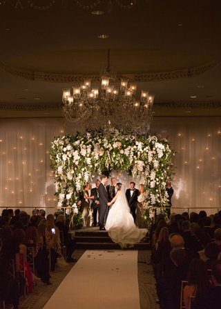 wedding-ceremony-ballroom-chuppah-twinkle-lights-behind-drapery-white-orchids-blush-flowers
