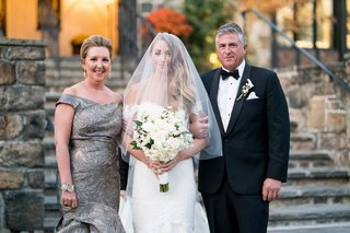 bride-in-anne-barge-wedding-dress-off-shoulder-with-father-of-bride-tuxedo-and-mother-in-grey-gown
