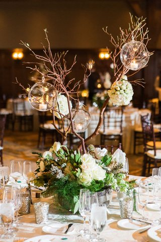 wedding-reception-greenery-white-flowers-tall-branches-with-glass-orb-candholders-centerpiece-rustic