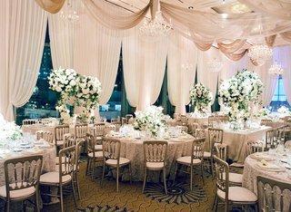 ballroom-wedding-in-chicago-with-drapery-on-windows-and-ceiling-green-and-white-centerpieces-silver