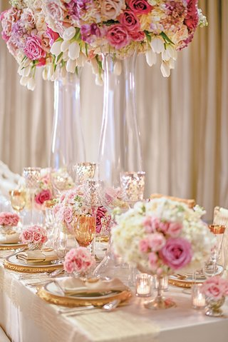 styled-shoot-table-with-pink-and-white-flowers-and-gold-plates