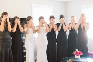 bridesmaids-in-black-dresses-katie-may-maids-of-honor-in-white-dresses-bridesmaid-first-look