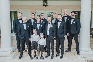 groom-and-groomsmen-in-black-suits-with-ring-bearers-in-shorts