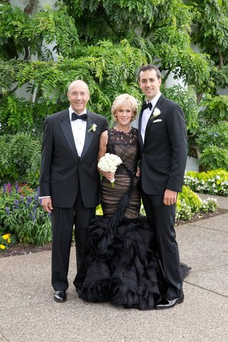 groom-with-father-and-mother-of-groom-in-black-mermaid-dress