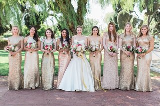 bride-in-trumpet-gown-with-bridesmaids-eight-in-gold-sequin-dresses-colorful-bouquets