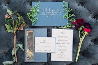 wedding-invitations-blue-envelopes-calligraphed-invitations-gold-flowers