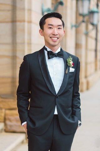smiling-groom-tuxedo-boutonniere-dayton-ohio-wedding-bow-tie-venue-classic-style