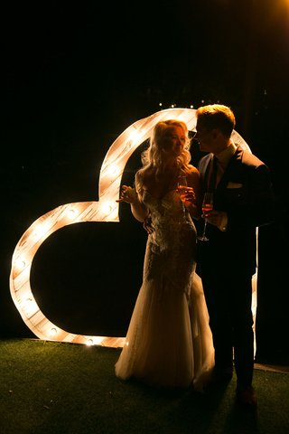 bride-in-pallas-couture-gown-with-blush-nude-lining-groom-in-navy-burberry-suit-light-up-heart