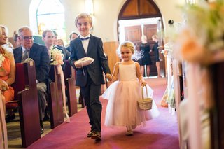 flower-girl-and-ring-bearer-holding-hands-as-they-walked-down-aisle-at-church-in-the-bahamas