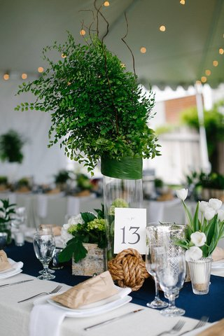 wedding-reception-with-navy-blue-table-runner-rope-sphere-and-greenery-centerpiece