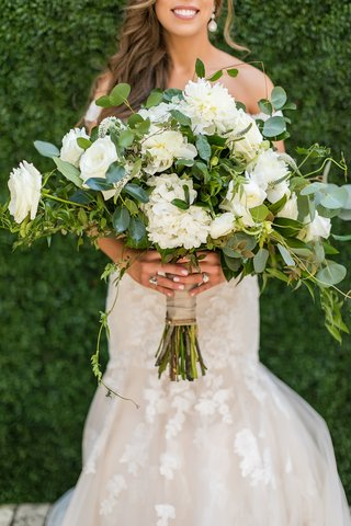 large-bridal-bouquet-with-white-flowers-and-lots-of-greenery