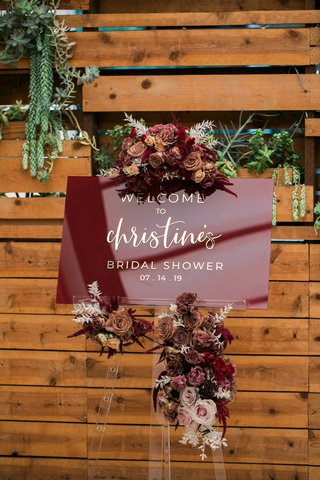 burgundy-acrylic-sign-with-gold-lettering-and-flowers-for-bridal-shower