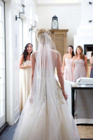 long-bridal-veil-chapel-length-church-length-champagne-dress-gown-bun-hairstyle