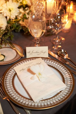 ornate-wedding-charger-plate-with-menu-and-belly-band-with-white-orchid-and-low-centerpieces