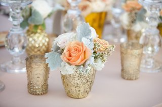 gilt-vase-filled-with-dusty-miller-roses-and-hydrangea