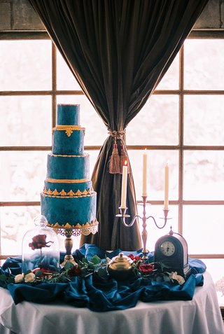 beauty-beast-movie-styled-wedding-shoot-blue-gold-cake-lumiere-candelabra-clock-rose-glass-case