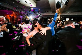 bride-and-groom-kiss-at-new-years-wedding