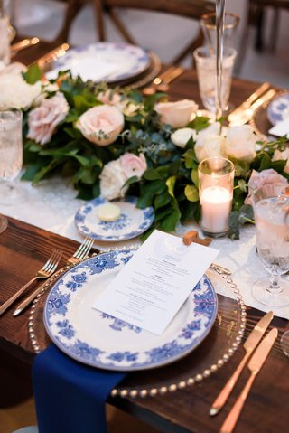wedding-reception-tablescape-wood-table-runner-pink-flowers-greenery-blue-white-chinoiserie-china