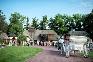 newlyweds-arrive-at-reception-on-a-carriage-drawn-by-two-clydesdales